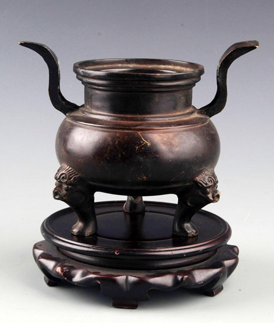 A TALL TWO HANDLE BRONZE CENSER