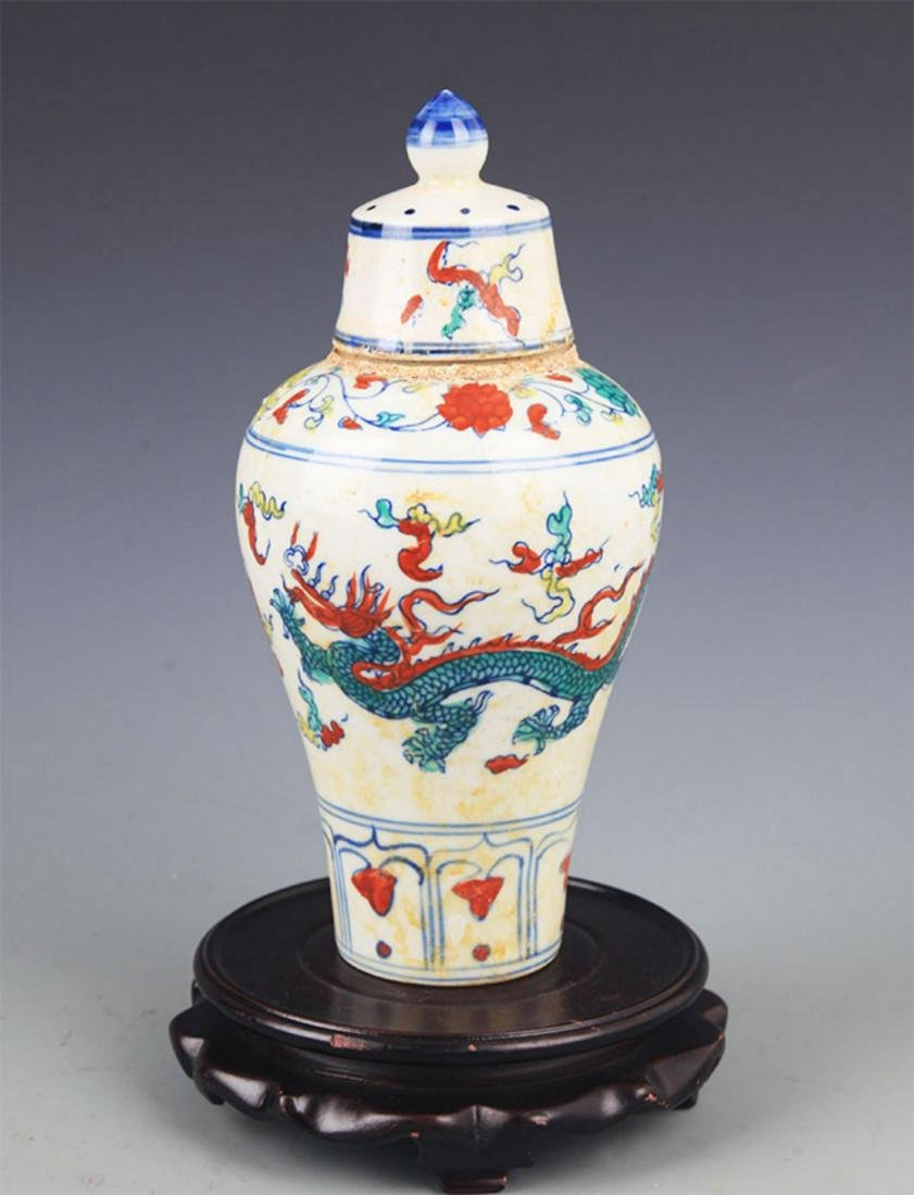A DRAGON PAINTED PORCELAIN WINE BOTTLE WITH COVER