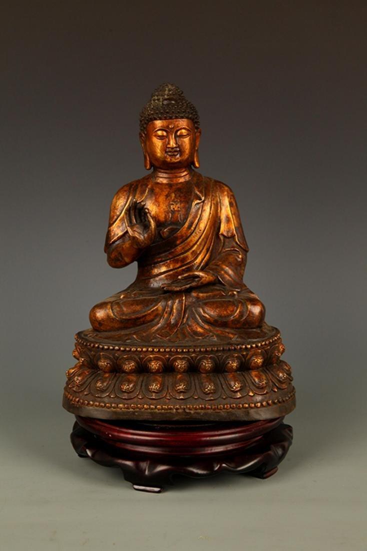 A FINELY CARVED AKSHOBHYA BUDDHA FIGURE