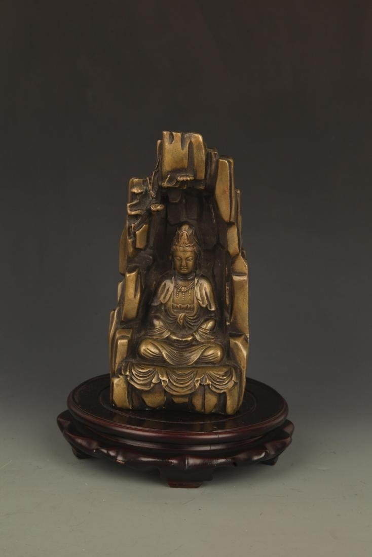 A FINELY CARVED BRONZE GUAN YIN