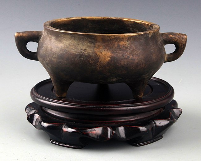 A FINE TRIPOD FOOT BRONZE CENSER