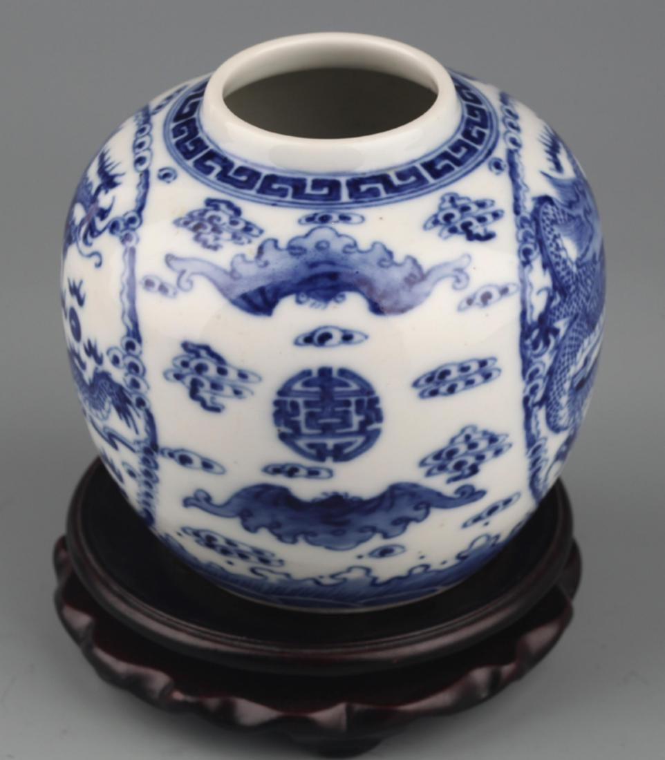 A BLUE AND WHITE DRAGON PAINTED PORCELAIN JAR - 4