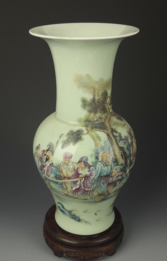 A GREEN GLAZE FAMILLE ROSE STORY PAINTED VASE