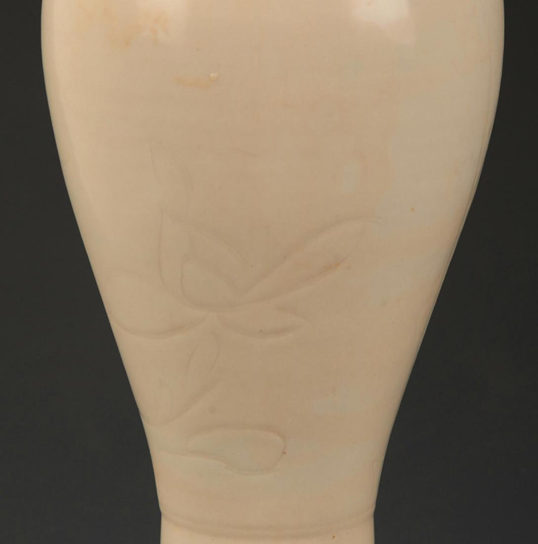 A DING KILN LOTUS CARVING MEI STYLE PORCELAIN BOTTLE - 4