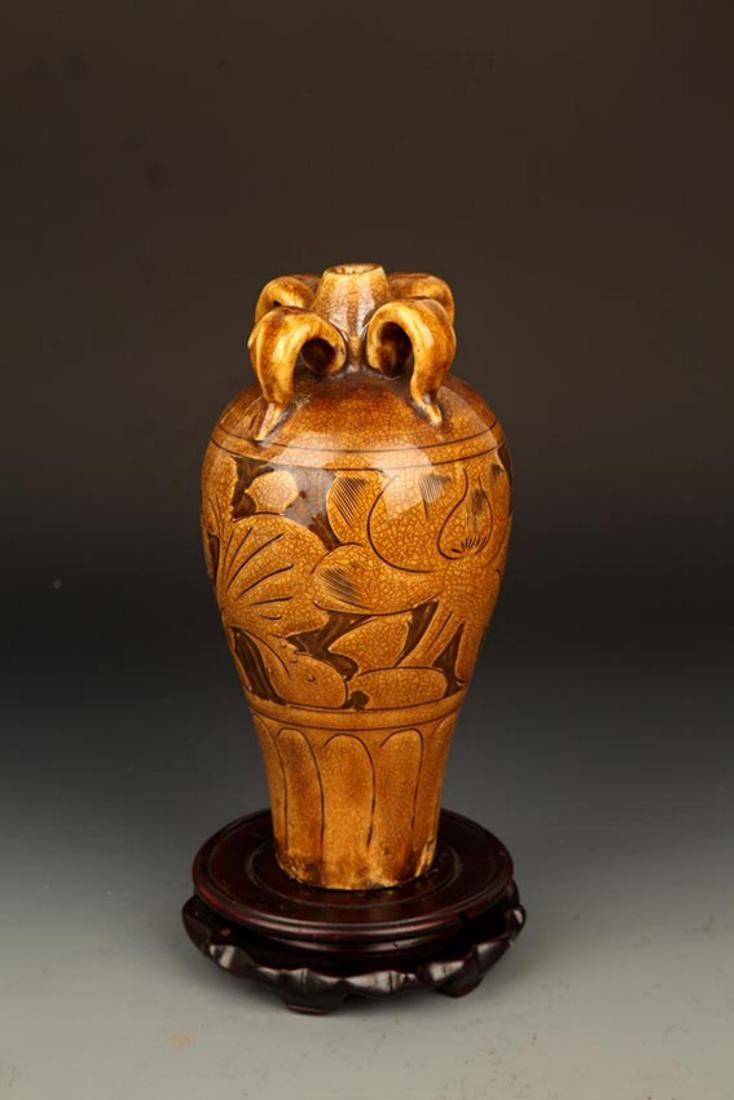 A BROWN COLOR GLAZED FLOWER CARVING PORCELAIN MEI