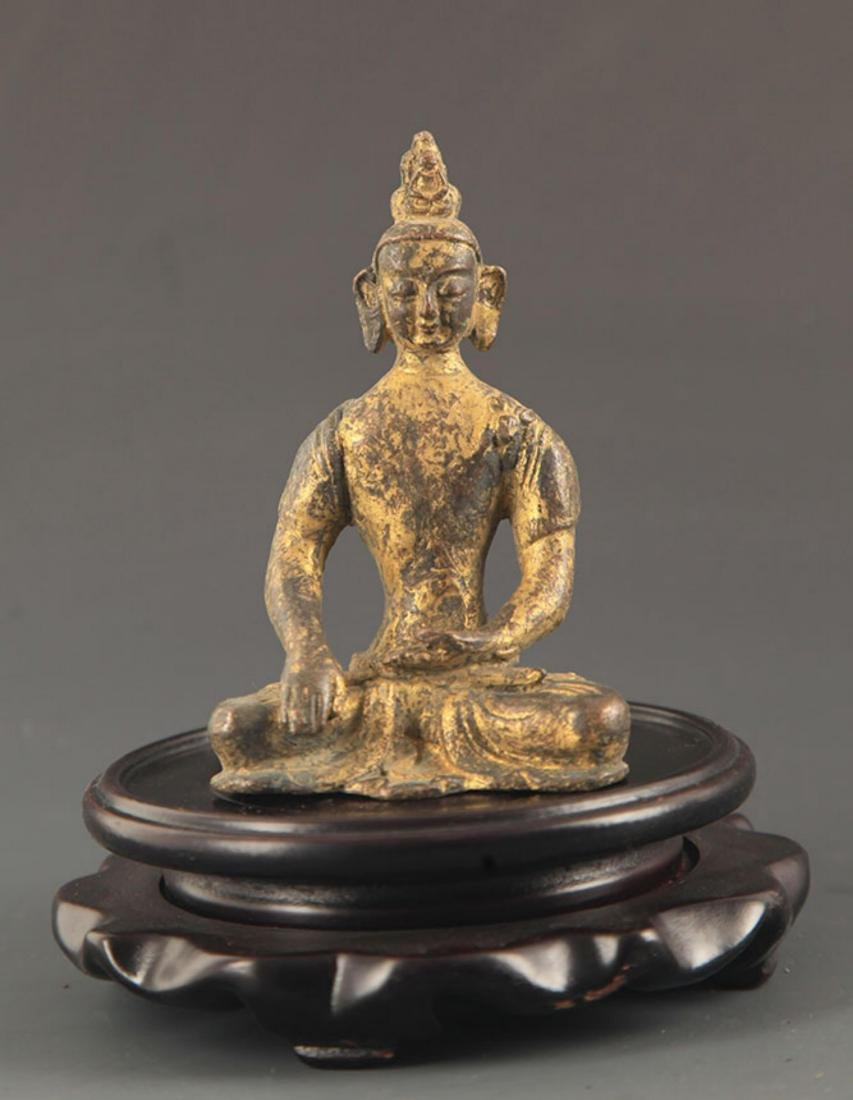 A BRONZE GILT AMITABHA FIGURE