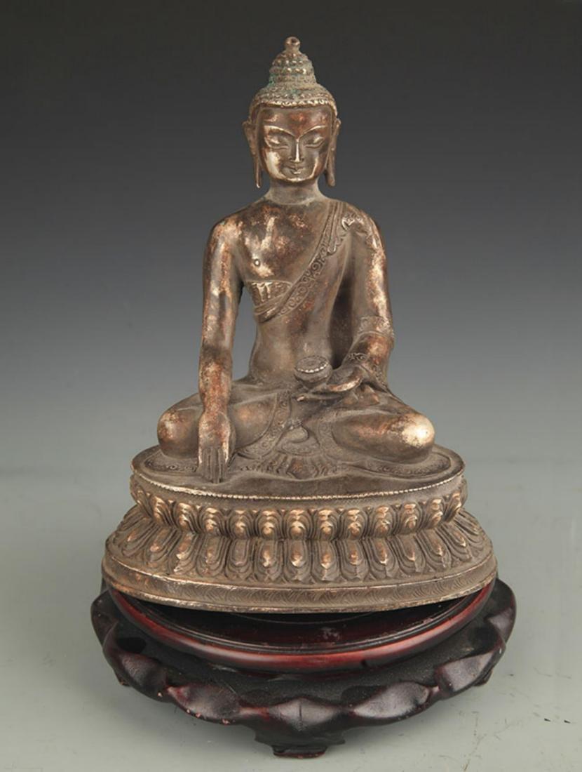 A FINE SILVER PLATED BHAISAJYAGURU BUDDHA STATUE
