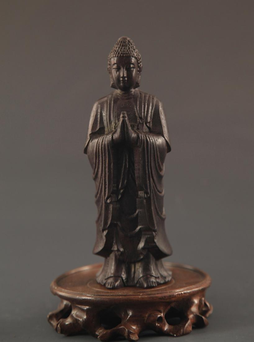 A SANDALWOOD GAUTAMA BUDDHA STATUE