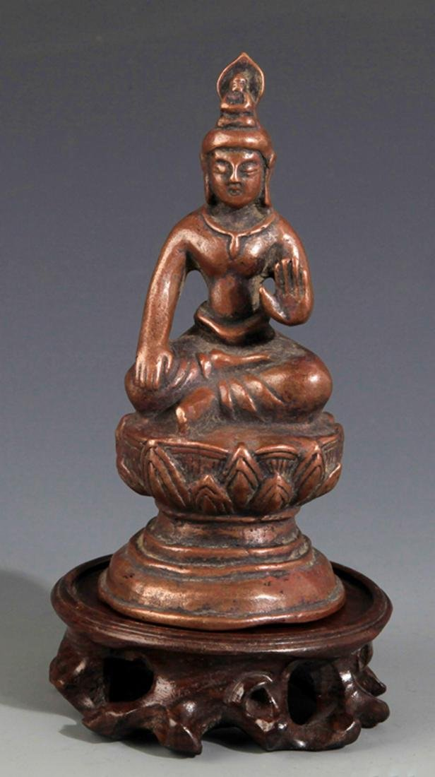 A SMALL BRONZE BUDDHA FIGURE