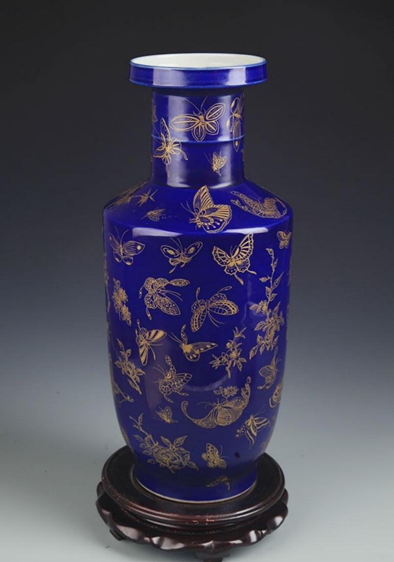 A DEEP BLUE GROUND, SPRINKLE GOLD WOOD CLUB STYLE VASE