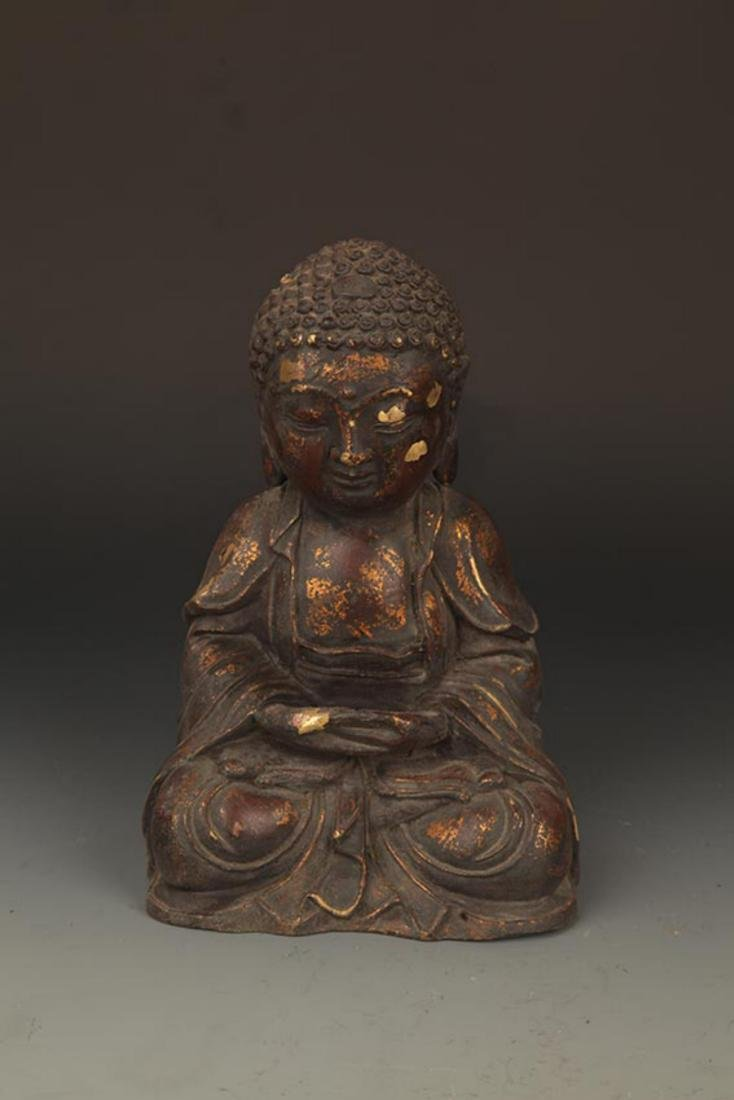 A FINELY CARVED CAST IRON TATHAGATA BUDDHA FIGURE