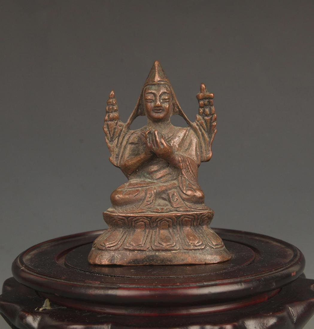 A FINELY CARVED BRONZE ZONGKABA FIGURE