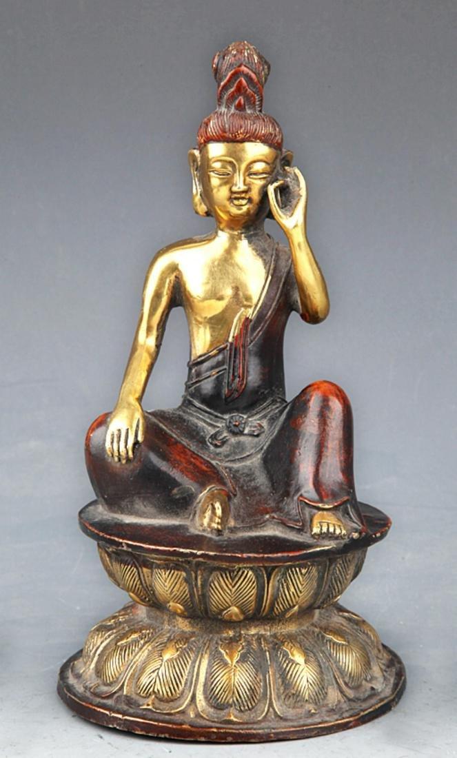 A COLORED AND GILT BRONZE BUDDHA