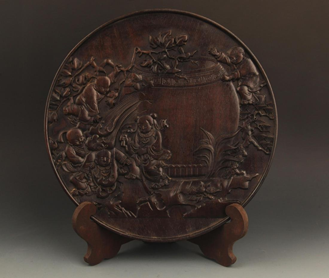 A FINELY CARVED ZI TAN PLATE