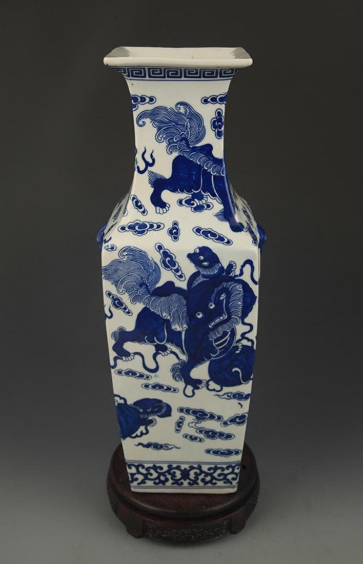 BLUE AND WHITE LION PLAYING PATTERN VASE