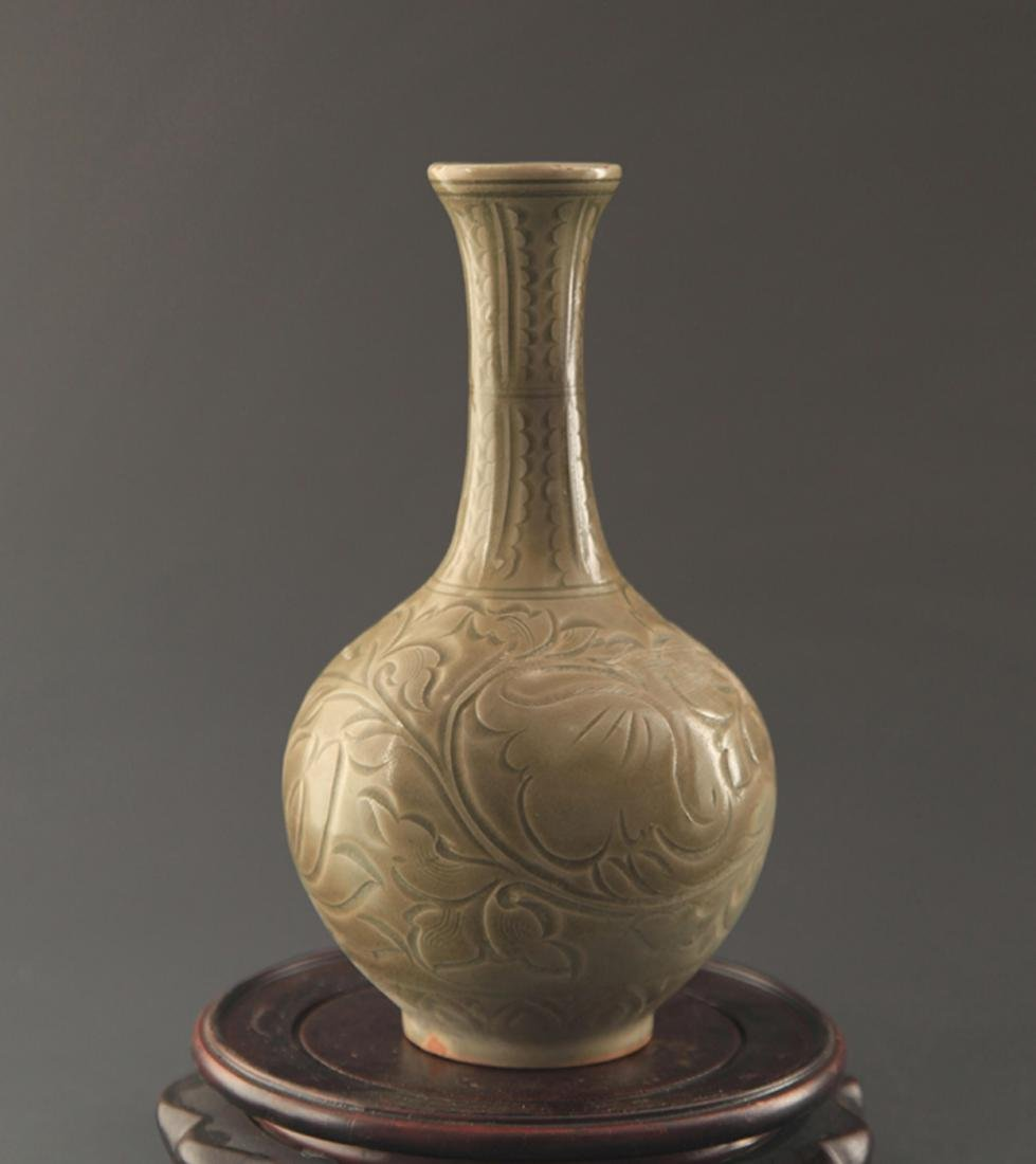 "A ""YAO ZHOU YAO"" FISH CARVING LONG NECK JAR"