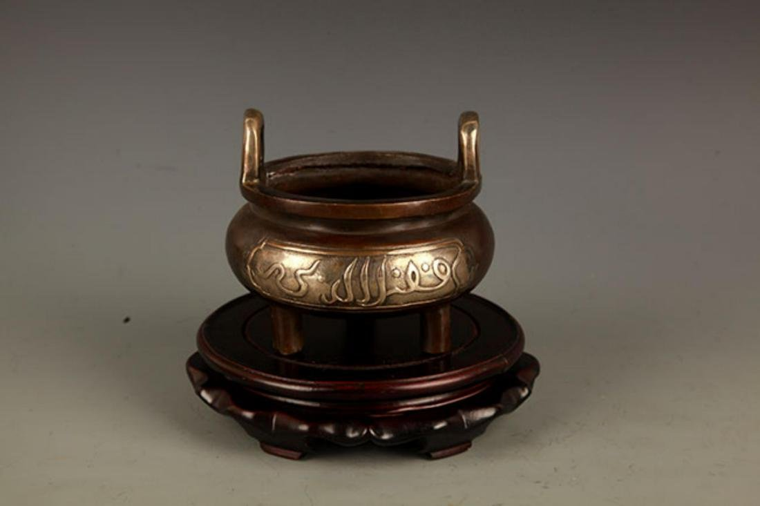 A DOUBLE EAR TRIPOD FOOT BRONZE CENSER