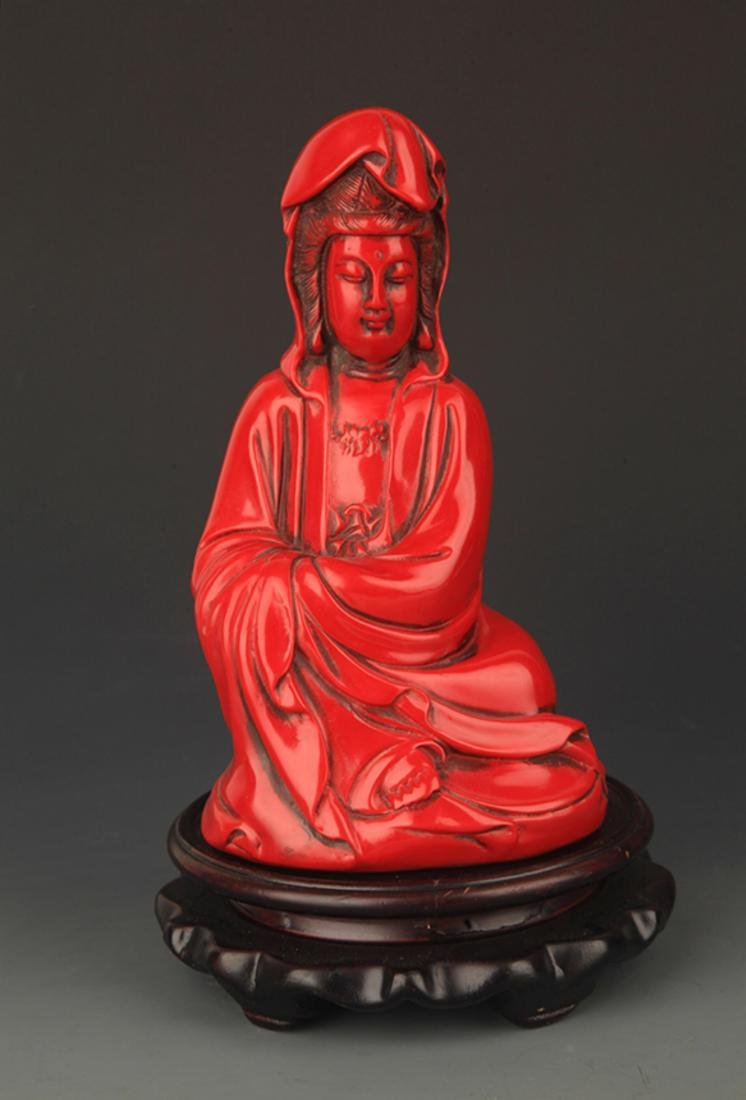 A FINE RED COLOR PLASTIC GUAN YIN STATUE