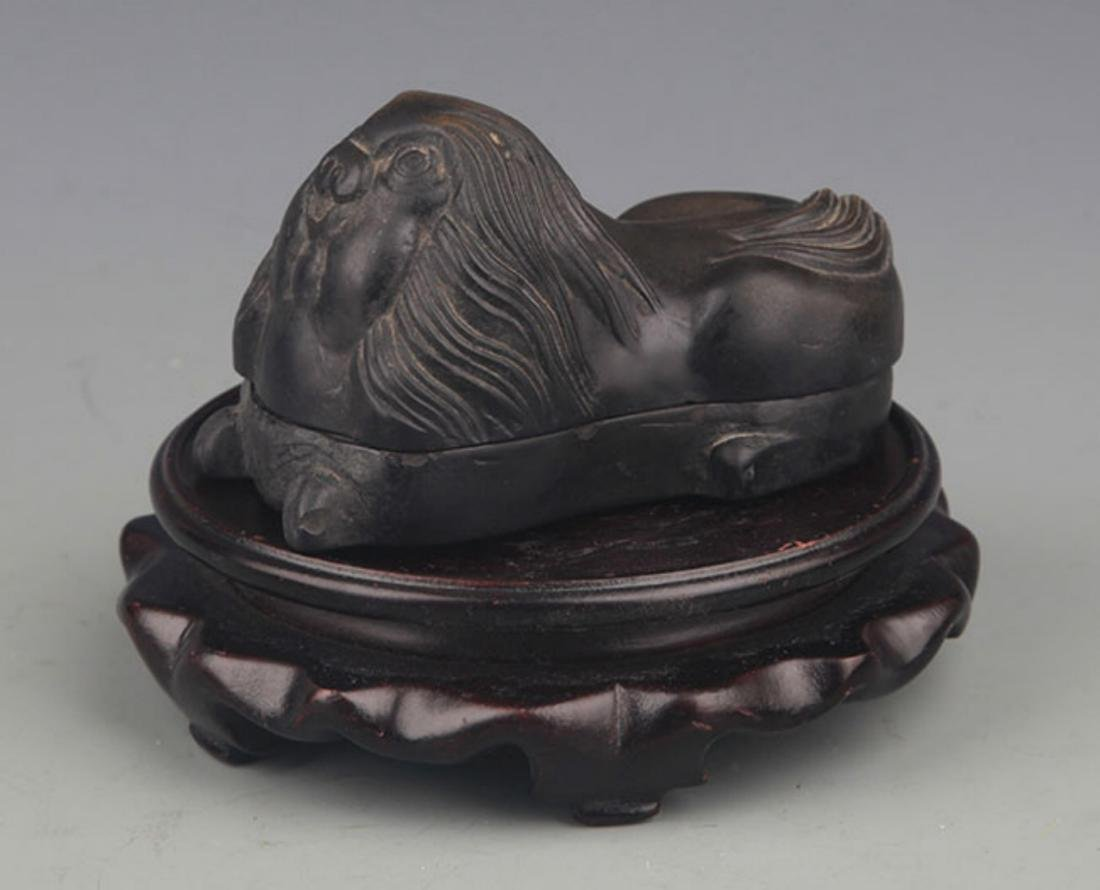 A FINE LION FIGURE STONE INK