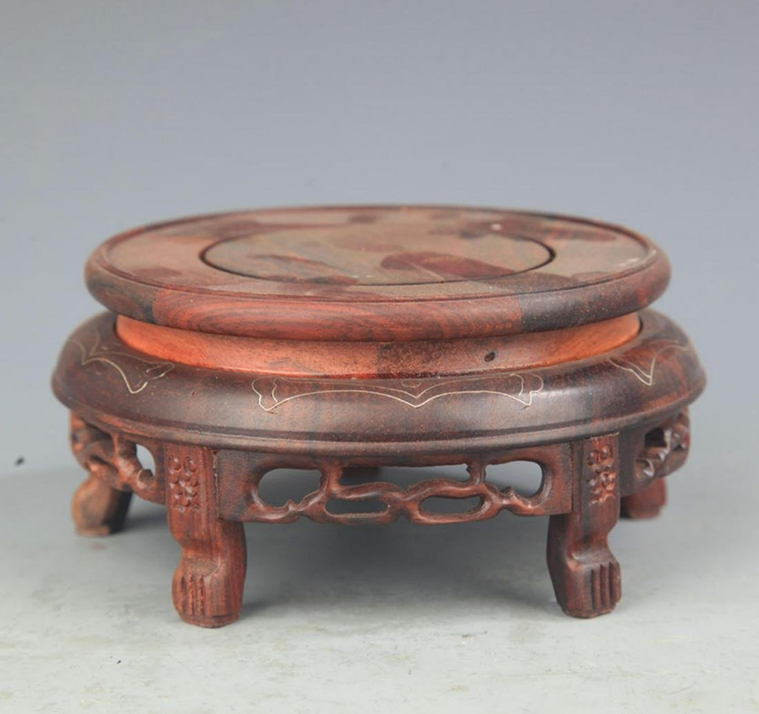 A RED WOOD HIGH FOOT BASE INLAY WITH SILVER LINE
