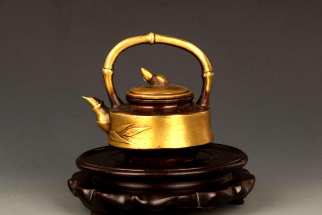 A BRONZE BAMBOO FIGURE BRONZE TEA POT