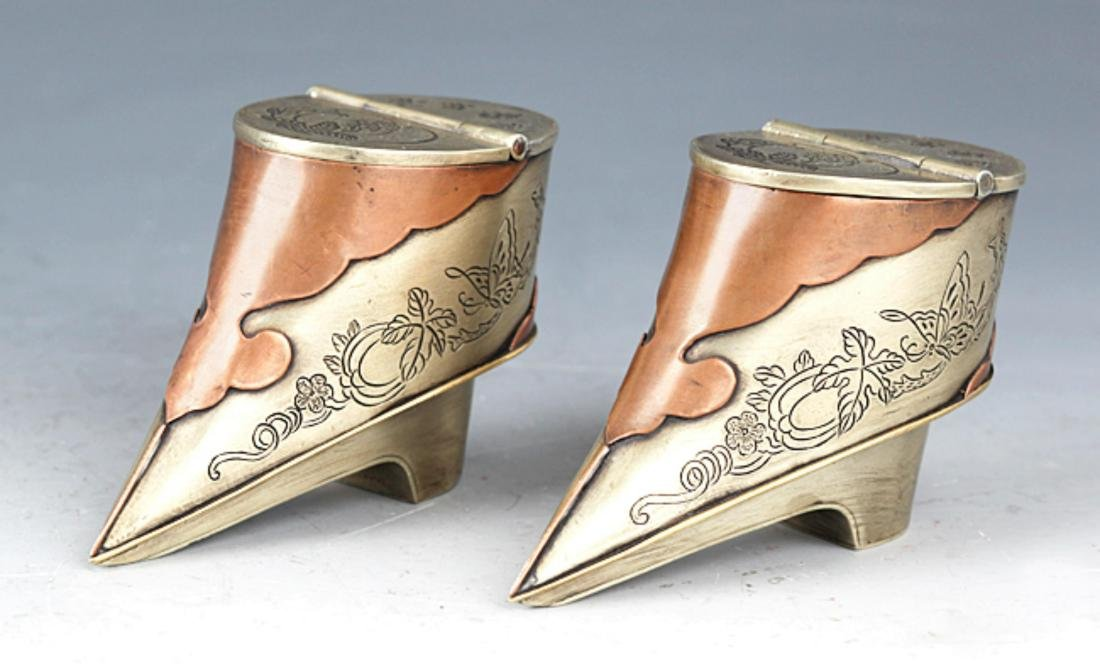 A PAIR OF SMALL SHOE SHAPE BRONZE TOBACCO BOX