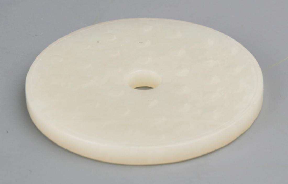 A ROUND GREENISH WHITE JADE - 3