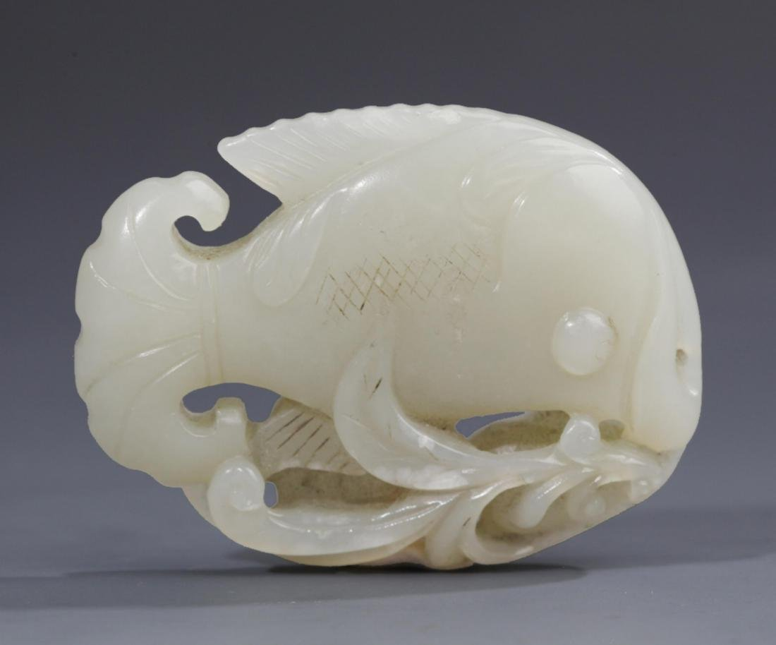 "A WHITE JADE PENDANT FIGURE OF ""FISH"""