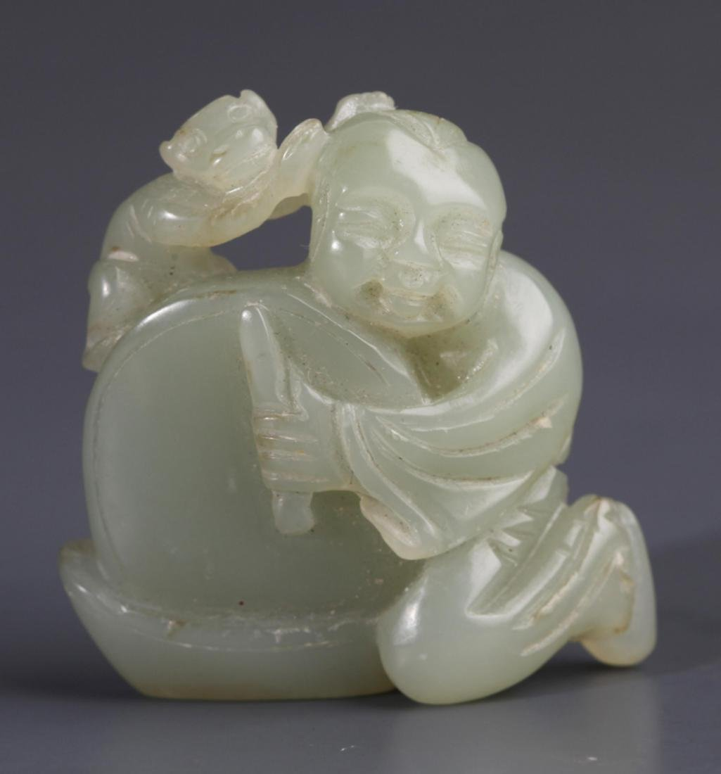 """A WHITE JADE PENDANT FIGURE OF """"PLAYING CHILDREN"""""""