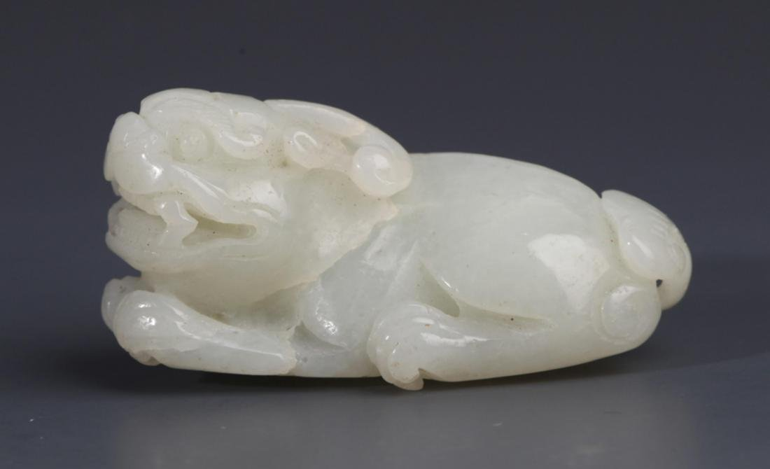 "A FINELY CARVED WHITE JADE ""RUI SHOU"" PENDANT"