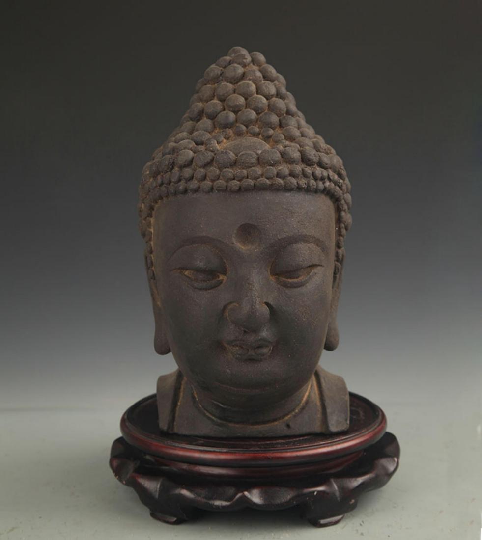 A FINE AGARWOOD BUDDHA HEAD