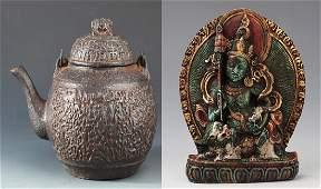 A TIBETAN BUDDHISM FIGURE AND CAST IRON TEAPOT
