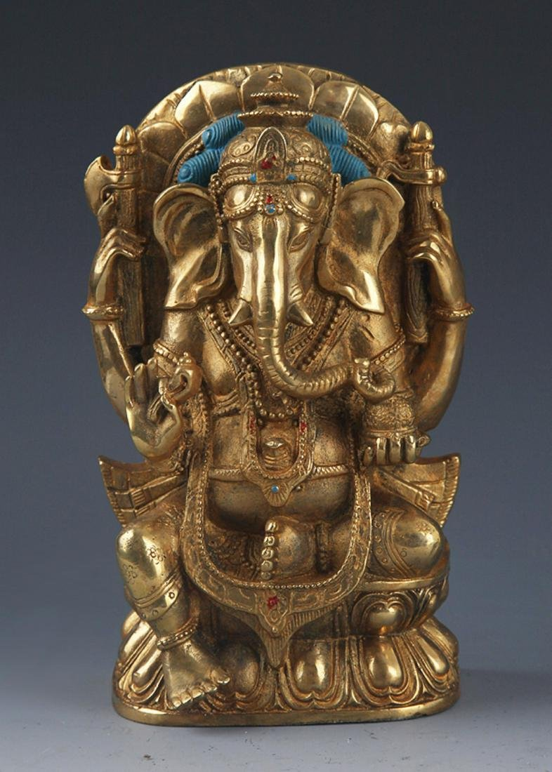 A FINELY BRONZE MODEL OF THE TRUNK GOD OF WEALTH