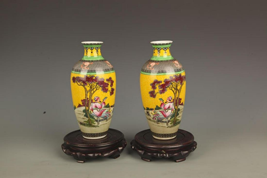 PAIR OF YELLOW GROUND STORY PAINTED PORCELAIN VASE