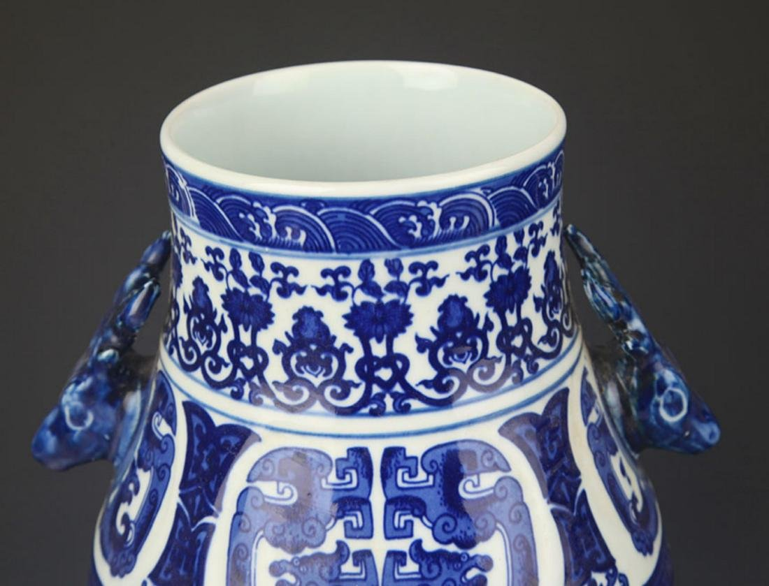 A BLUE AND WHITE DEER HEAD HANDLE VASE - 2