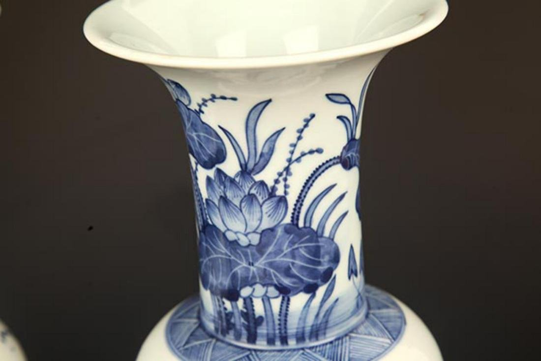 A BLUE AND WHITE LOTUS PAINTED PORCELAIN VASE - 2