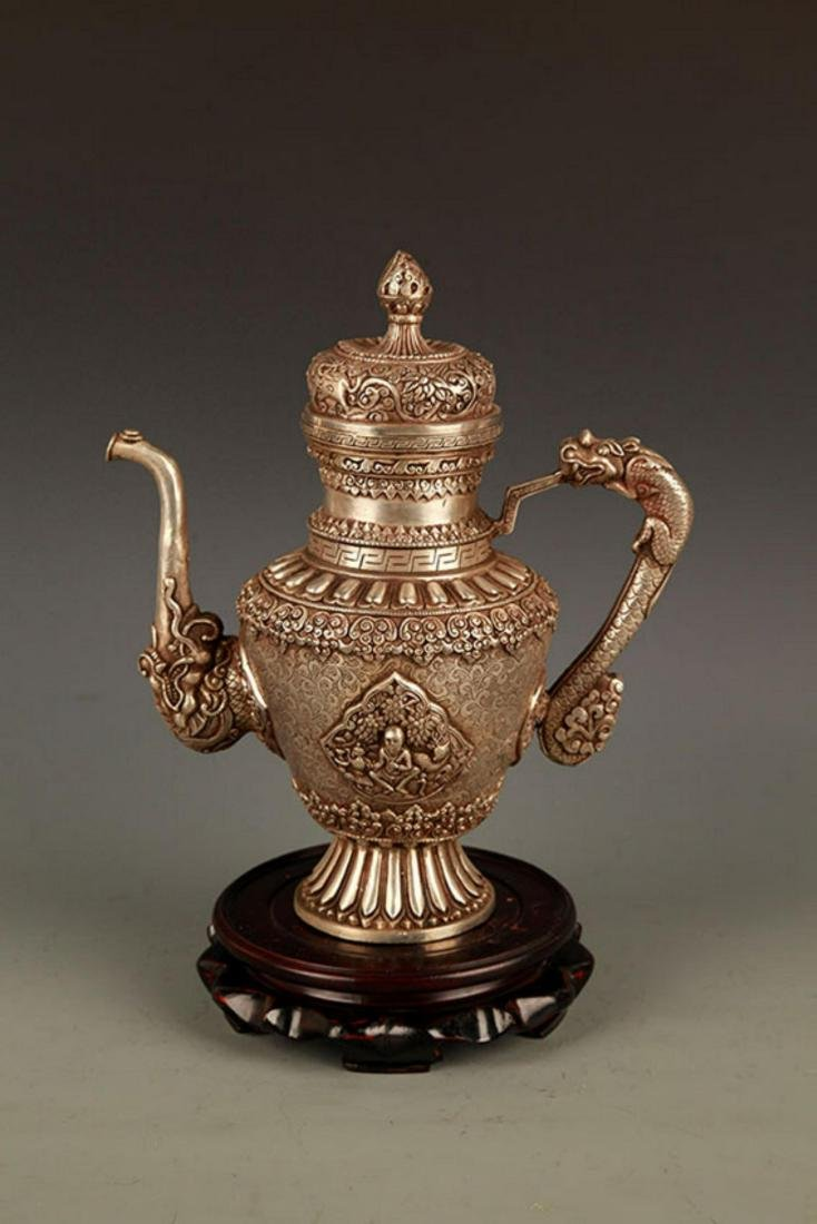 A TIBETAN BUDDHISM DRAGON HANDLE EWER