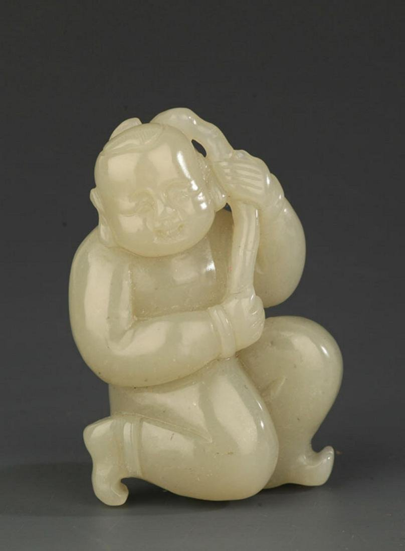 A FINE HETIAN JADE PENDANT IN FIGURE OF BOY PLAYING