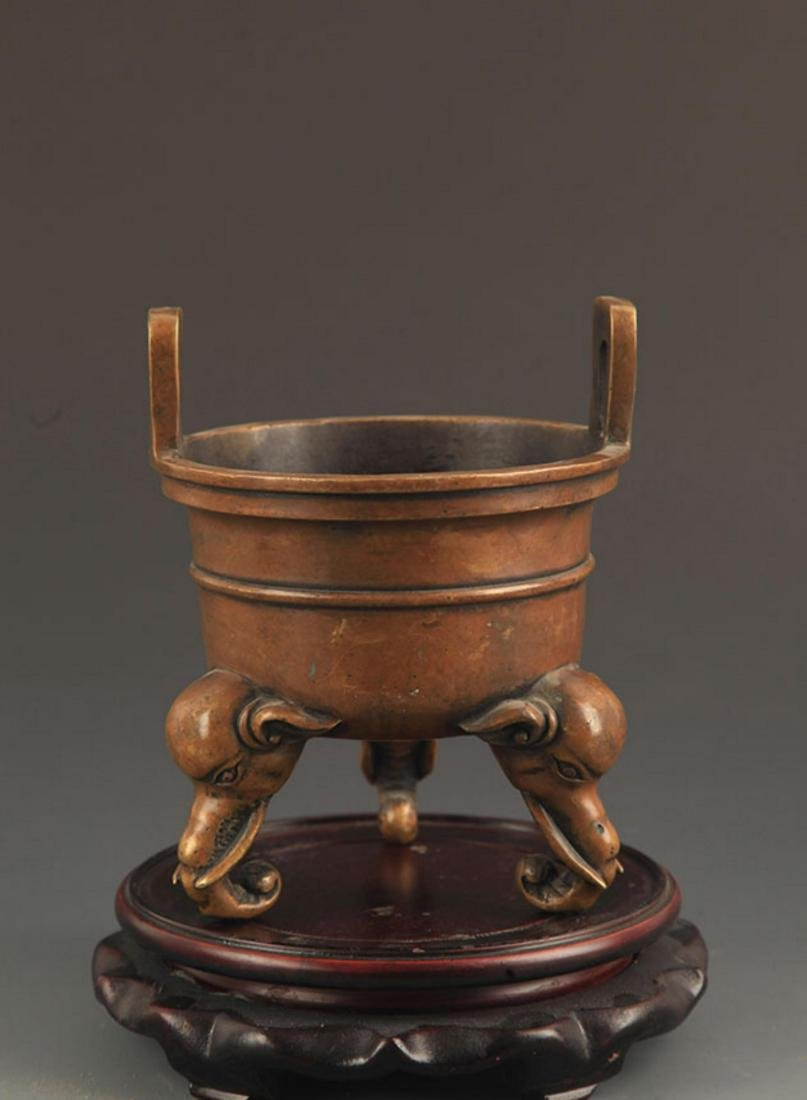 AN ELEPHANT FOOT DOUBLE EAR BRONZE CENSER