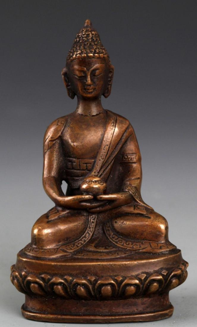 A BRONZE MODEL OF AKSHOBHYA BUDDHA