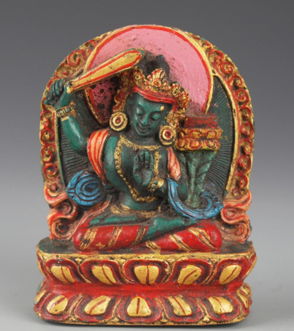 A FINELY CARVED TURQUOISE STONE TIBETAN BUDDHA