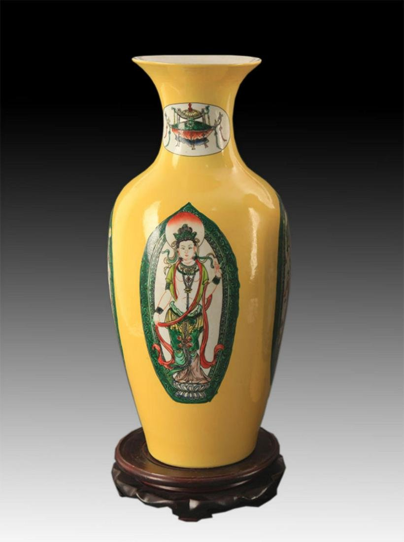 A YELLOW GLAZED FAMILLE-VERTE GUAN YIN BOTTLE