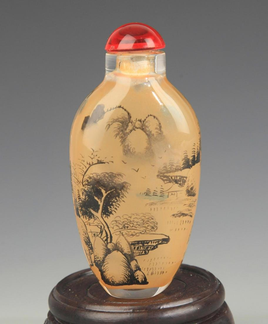 A LANDSCAPE PAINTED GLASS SNUFF BOTTLE