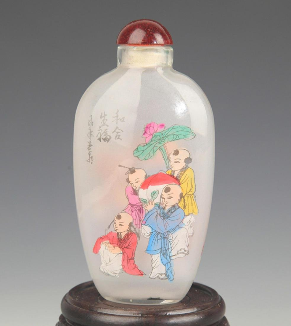 A  FINE BOY PLAYING PAINTED GLASS SNUFF BOTTLE