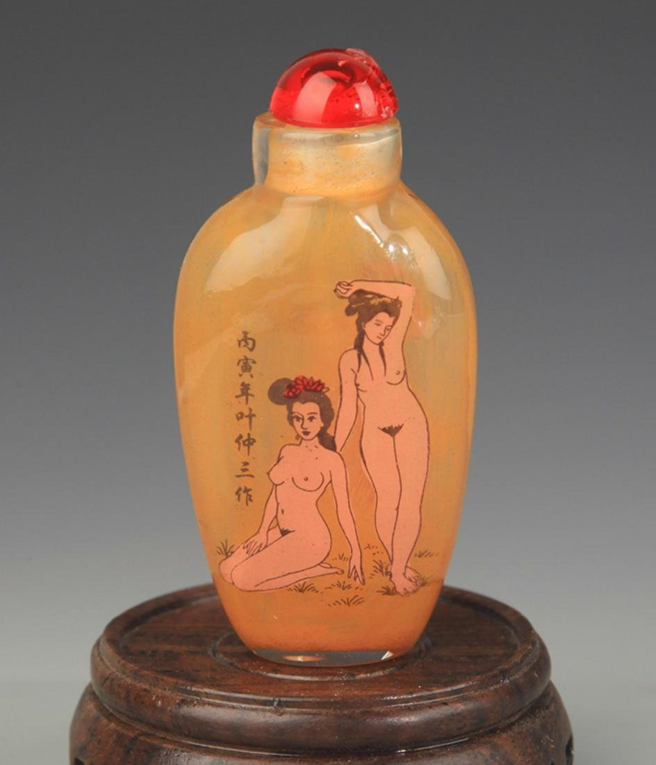A FINE FEMALE PAINTED GLASS SNUFF BOTTLE