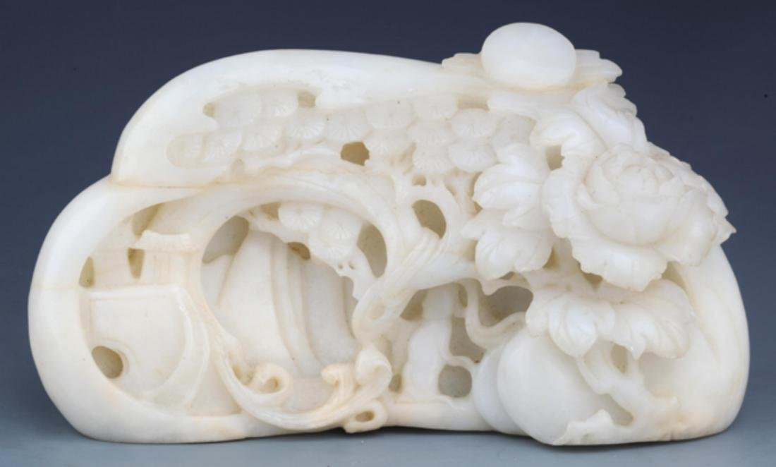 A RARE AND FINELY CARVED WHITE JADE DECORATION