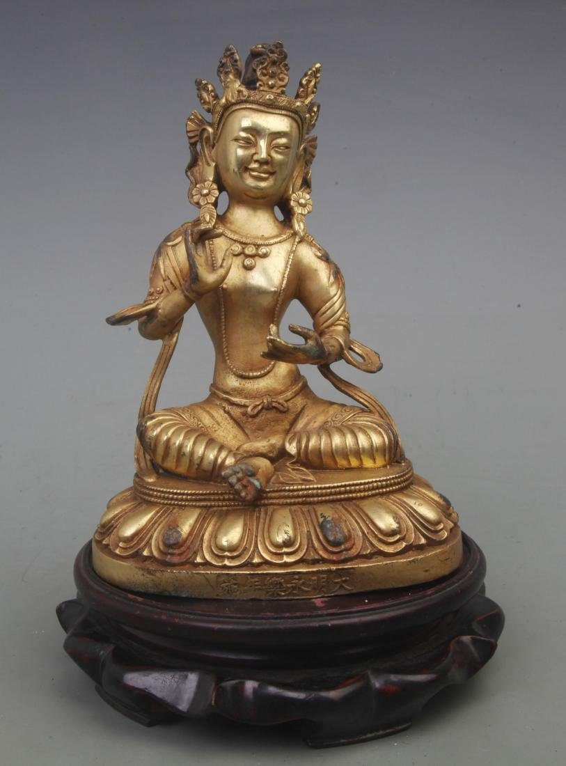 A REAR GILT BRONZE TREASURE BUDDHA FIGURE