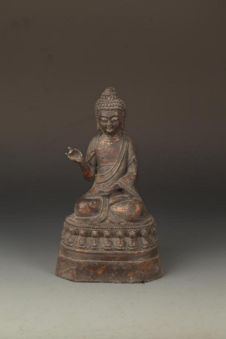 A FINE CAST IRON FIGURE OF TATHAGATA BUDDHA