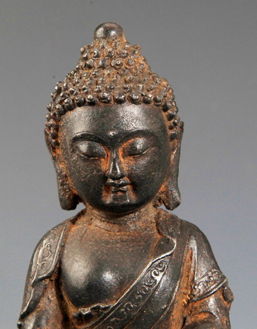 A FINELY CARVED IRON MADE AKSHOBHYA BUDDHA - 2