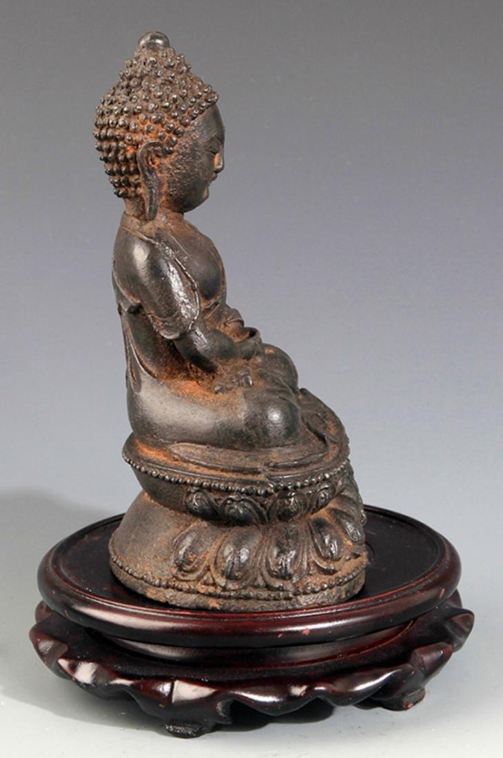 A FINELY CARVED IRON MADE AKSHOBHYA BUDDHA - 3